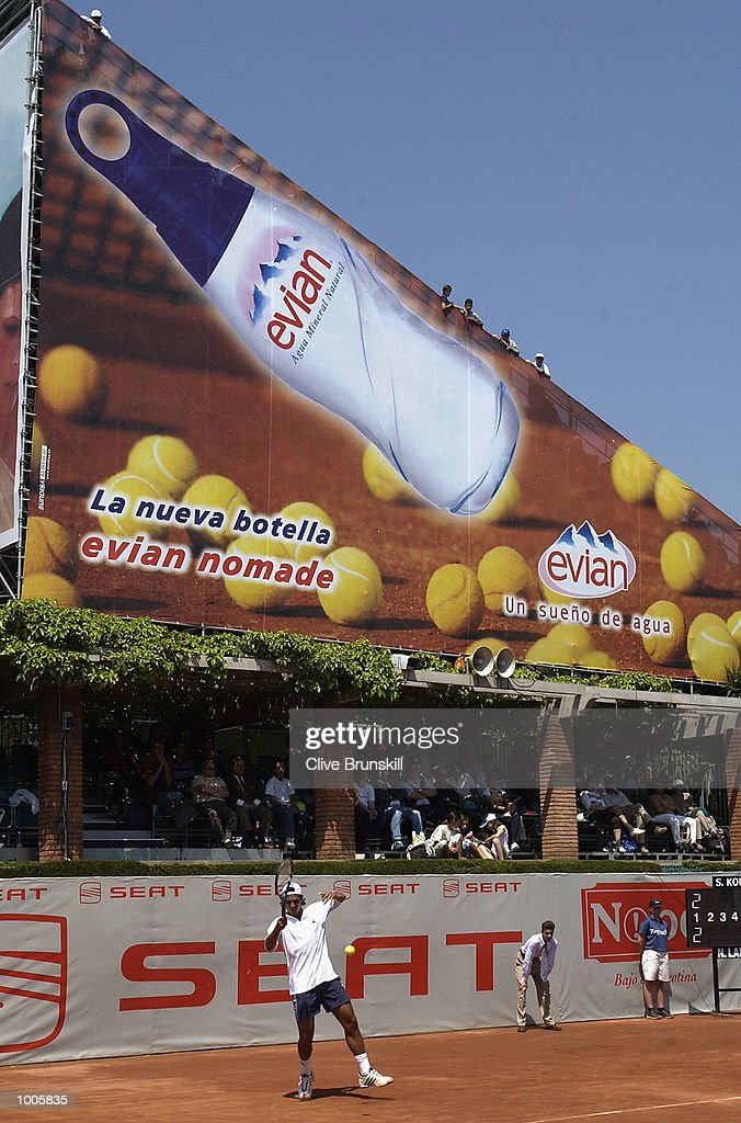 Nicolas Lapentti of Ecuador plays in front of the giant advertising boards on court 1, in his first round match against Stefan Koubek of Austria during the Open Seat Godo 2002 held in Barcelona, Spain. DIGITAL IMAGE Mandatory Credit: Clive Brunskill/Getty Images