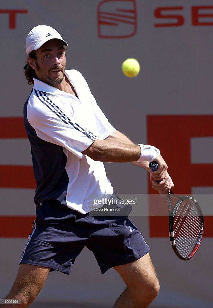 Nicolas Massu of Chile plays a backhand during his first round match against Galo Blanco of Spain during the Open Seat Godo, Barcelona, Spain . DIGITAL IMAGE Mandatory Credit: Clive Brunskill/Getty Images