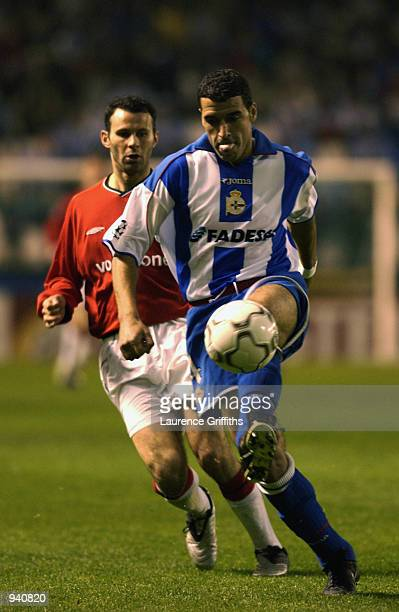 Nourredine Naybet of Deportivo La Coruna controls the ball as Ryan Giggs of Manchester United closes in during the UEFA Champions League...