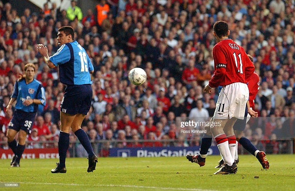 Ole Gunnar Solskjaer (Hidden) of Man Utd scores the first goal during the Manchester United v Bayer Leverkusen UEFA Champions League Semi Final, First Leg match from Old Trafford, Manchester. DIGITAL IMAGE Mandatory Credit: Ross Kinnaird/Getty Images