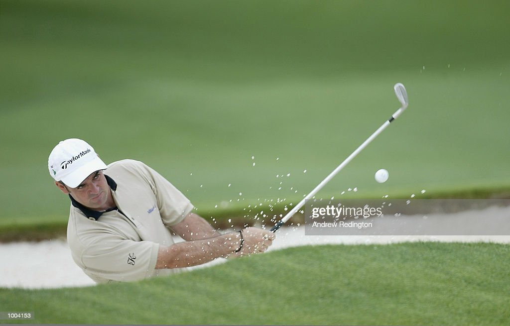 Paul McGinley of Ireland plays out of the bunker on the 18th hole during the third day of the Masters Tournament from the Augusta National Golf Club in Augusta, Georgia. DIGITAL IMAGE. EDITORIAL USE ONLY Mandatory Credit: Andrew Redington/Getty Images