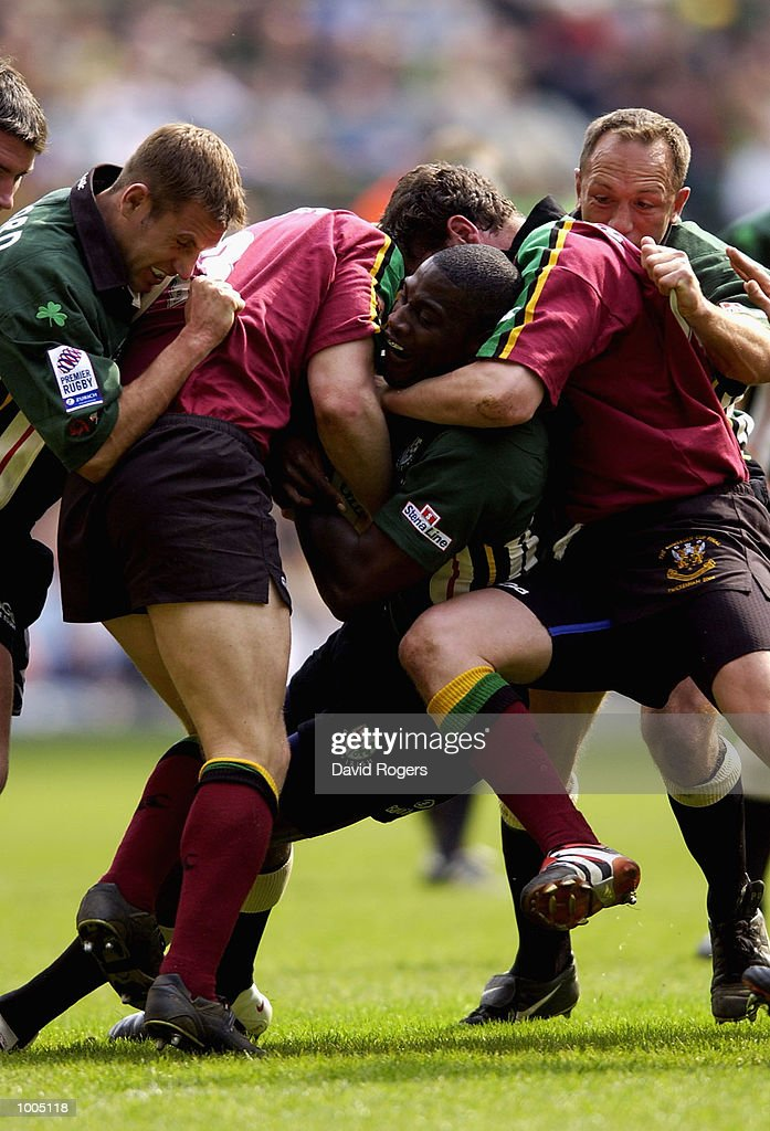 Paul Sackey of London Irish is stopped by the Northampton defence during the Powergen Cup Final between Nothampton Saints and London Irish at Twickenham, London. DIGITAL IMAGE. Mandatory Credit: Dave Rogers/Getty Images