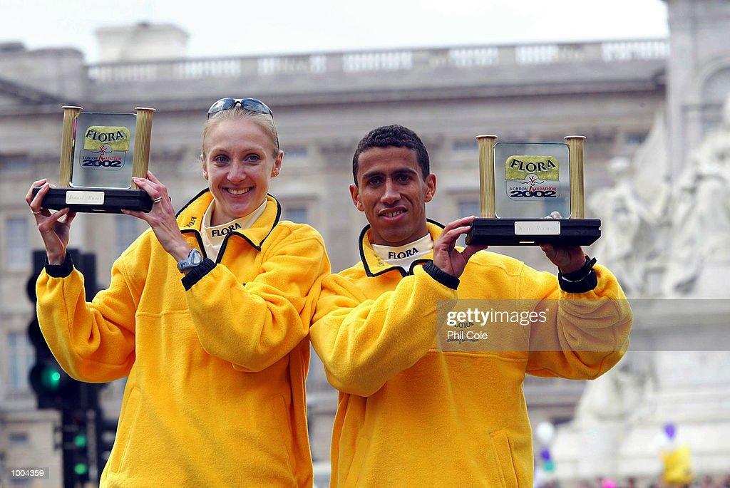 Paula Radcliffe of England and Khalid Khannouchi of USA celebrates after winning the Flora London Marathon Elite Mens and Womens races London. DIGITAL IMAGE Mandatory Credit: Phil Cole/Getty Images