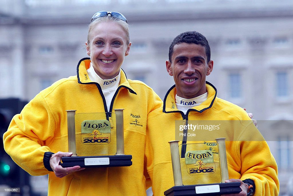 Paula Radcliffe of England and Khalid Khannouchi of USA celebrates after winning the Flora London Marathon Elite Mens and Womens races London. DIGITAL IMAGE Mandatory Credit: Phil Cole/Getty Images
