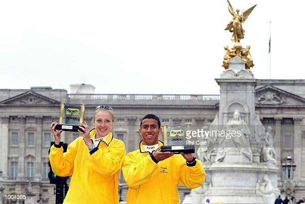 Paula Radcliffe of England and Khalid Khannouchi of USA celebrates after winning the Flora London Marathon Elite Mens and Womens races London DIGITAL...