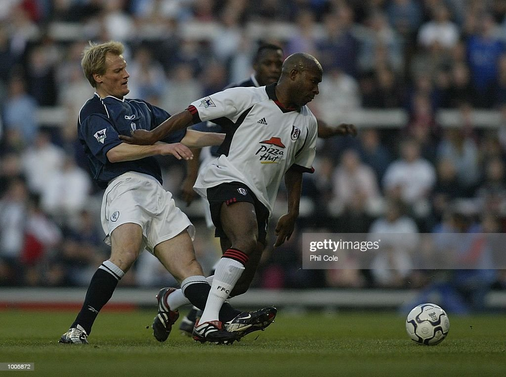 Per Frandsen of Bolton Wanderers tries to tackle Barry Hayles of Fulham during the FA Barclaycard Premiership match between Fulham and Bolton Wanderers at Craven Cottage, London. DIGITAL IMAGE Mandatory Credit: Phil Cole/Getty Images