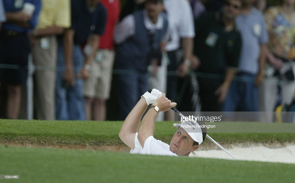 Phil Mickelson of the USA plays his second shot from the bunker on the first hole during the final round of the Masters Tournament from the Augusta National Golf Club in Augusta, Georgia. DIGITAL IMAGE. EDITORIAL USE ONLY Mandatory Credit:Andrew Redington/Getty Images
