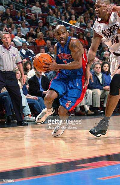 Point guard Chucky Atkins of the Detroit Pistons drives past forward Derrick Coleman of the Philadelphia 76ers during the NBA game at the First Union...