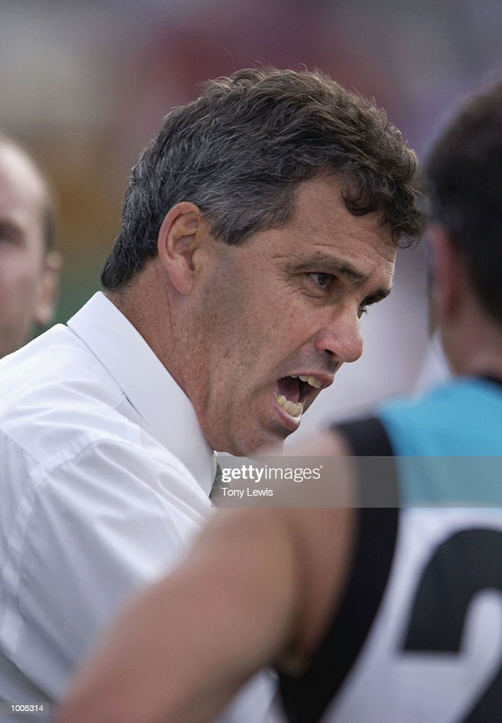 Port Adelaide coach mark Williams speaks to his players at three quarter time in the match between Port Power and the Carlton Blues in round 4 of the AFL played at Football Park in Adelaide, Australia. Port Adelaide 23.10 (148) defeated Carlton 14.11 (95) DIGITAL IMAGE Mandatory Credit: Tony Lewis/Getty Images