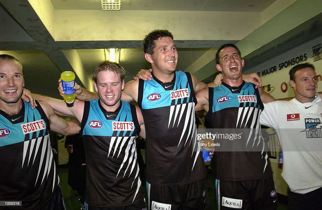 Port Adelaide players sing the club song after winning the match between Port Power and the Carlton Blues in round 4 of the AFL played at Football Park in Adelaide, Australia. Port Adelaide 23.10 (148) defeated Carlton 14.11 (95) DIGITAL IMAGE Mandatory Credit: Tony Lewis/Getty Images