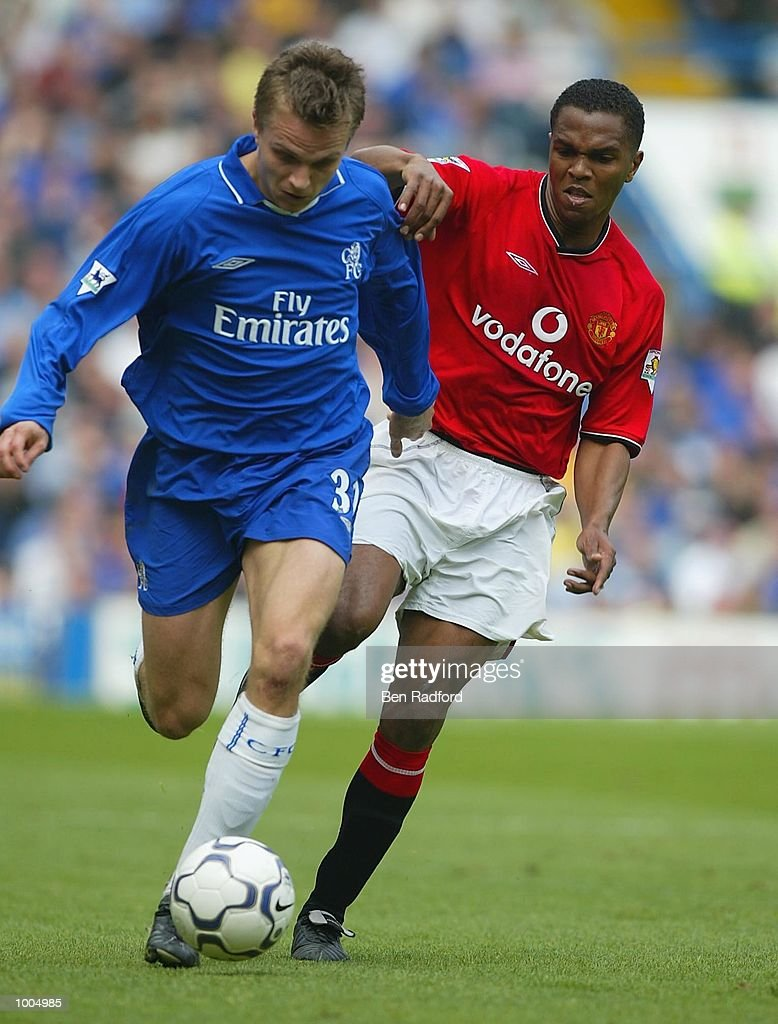 Quinton Fortune of Manchester United tries to tackle Jesper Gronkjer of Chelsea during the FA Barclaycard Premiership match between Chelsea and Manchester United at Stamford Bridge, London. DIGITAL IMAGE Mandatory Credit: Ben Radford/Getty Images