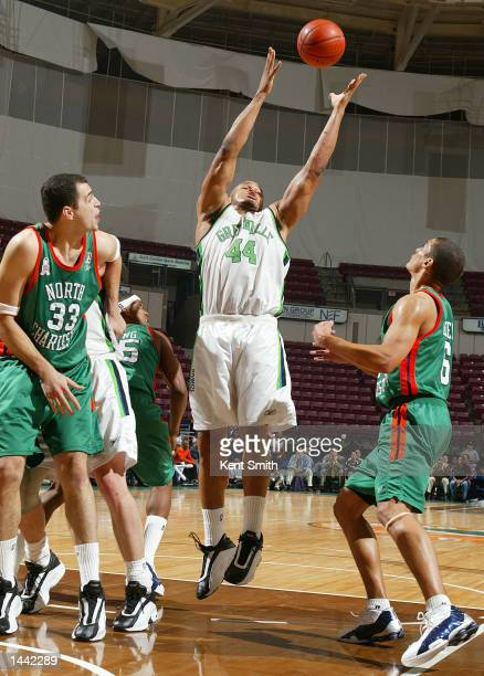 Rahim Lockhart of the Greenville Groove pulls in a rebound against Nate Green and Victor Avila of the North Charleston Lowgators in Game 2 of the...