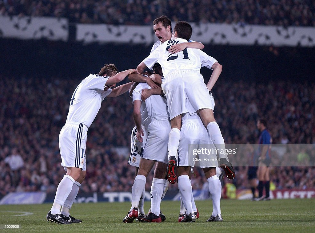 Real Madrid players mob Zinedine Zidane after he had scored the first goal during the UEFA Champions League Semi Final First Leg match between Barcelona and Real Madrid at the Nou Camp, Barcelona, Spain. DIGITAL IMAGE Mandatory Credit: Clive Brunskill/Getty Images
