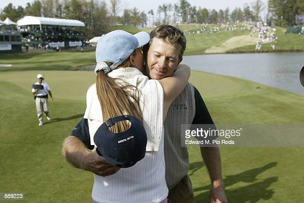 Retief Goosen of South Africa hugs his wife Tracy after completing Sunday's final round of the BellSouth Classic at TPC Sugarloaf in Duluth Georgia...