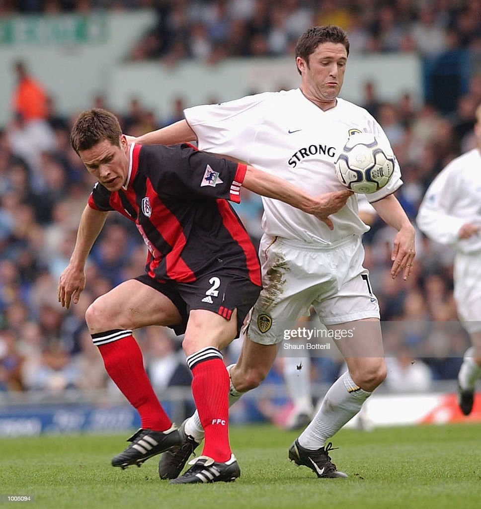 Robbie Keane of Leeds holds off Steve Finnan of Fulham during the Leeds United v Fulham Barclaycard Premiership match played at Elland Road, Leeds. DIGITAL IMAGE Mandatory Credit: Shaun Botterill/Getty Images