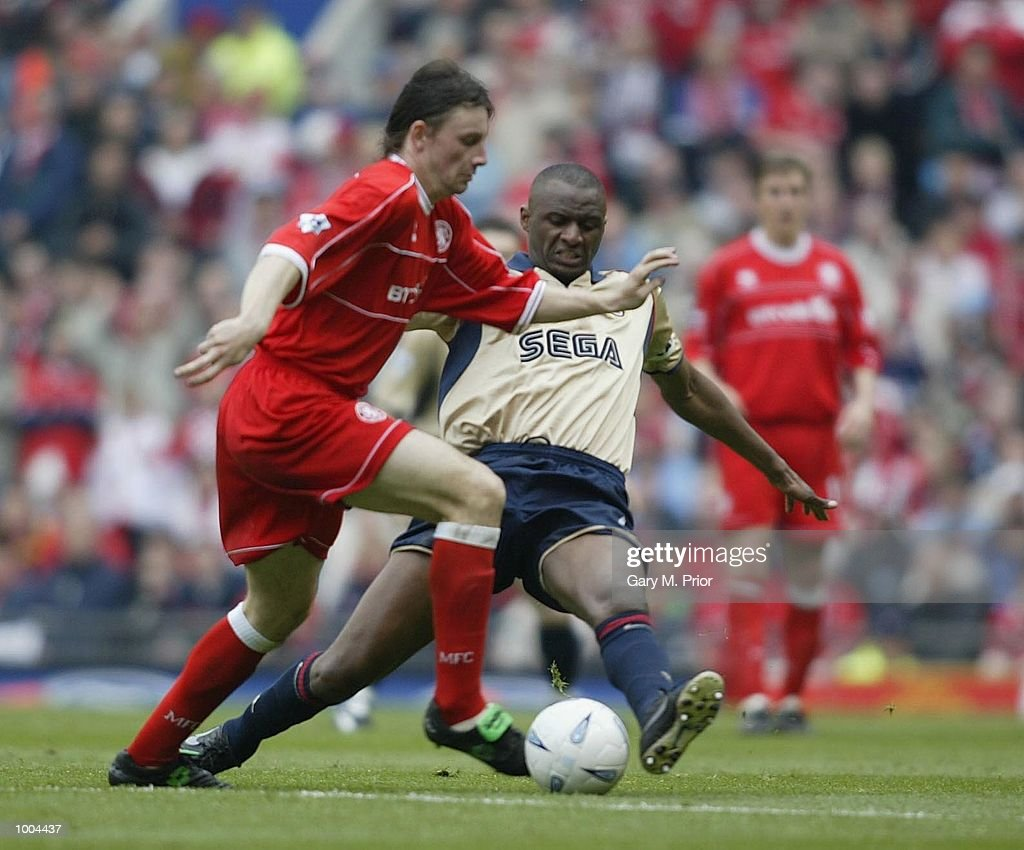 Robbie Stockdale of Boro is tackled by Patrick Vieira of Arsenal during the AXA sponsored FA Cup semi final tie between Middlesbrough v Arsenal at Old Trafford Stadium, Manchester. DIGITAL IMAGE. Mandatory Credit: Gary M. Prior/Getty Images