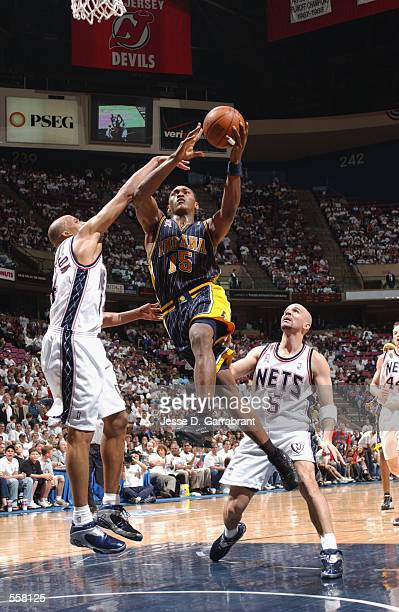 Ron Artest of the Indiana Pacers goes to the basket defended by Richard Jefferson of the New Jersey Nets during round one of the playoffs at...