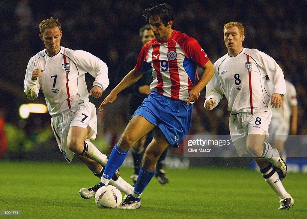 Roque Santa Cruz of Paraguay is put under pressure by Nicky Butt of England during the Nationwide friendly match between England and Paraguay at Anfield, Liverpool. DIGITAL IMAGE. Mandatory Credit: Clive Mason/Getty Images