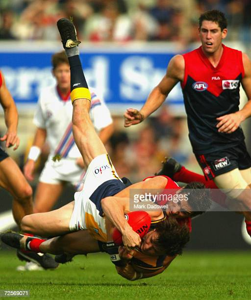 Rowan Jones for the Eagles is tackled by Adem Yze for Melbourne during the Round 4 AFL match between the Melbourne Demons and the West Coast Eagles...