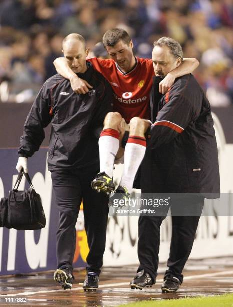 Roy Keane of Man Utd is carried off injured during the Deportivo La Coruna v Manchester United UEFA Champions League Quarter Final 1st Leg match at...
