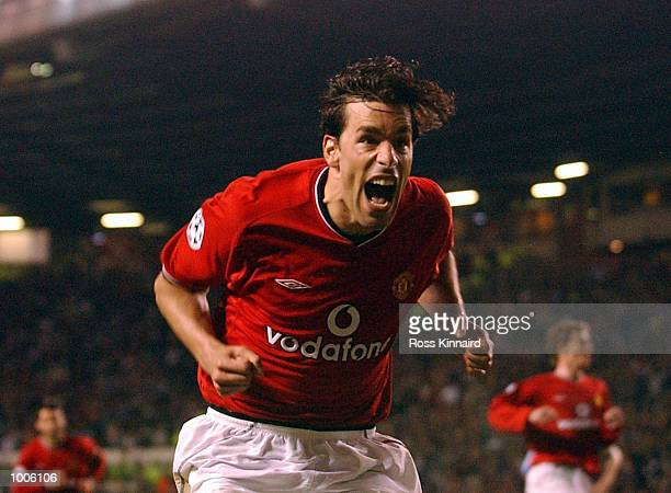 Ruud Van Nistelrooy of Man Utd celebrates after scoring the second goal with a penalty during the Manchester United v Bayer Leverkusen UEFA Champions...
