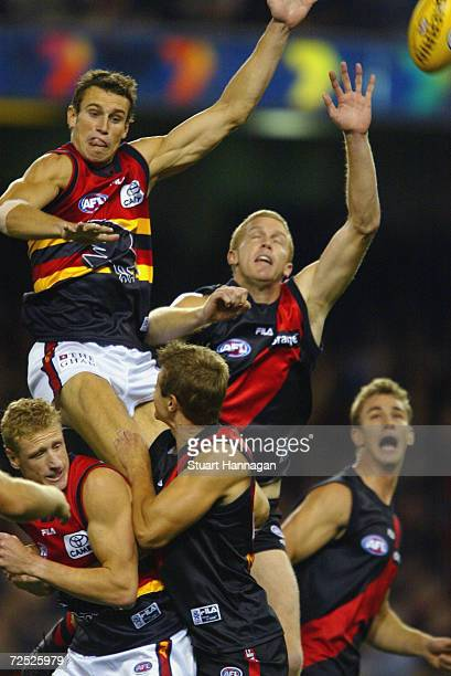Ryan Fitzgerald of Adelaide fly's for the ball over Dustin Fletcher of Essendon during the AFL Match between Essendon Bombers and the Adelaide Crows...