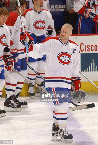 Saku Koivu of the Montreal Canadiens waves to the crowd as he recieves a standing ovation at the start of the game against the Ottowa Senators at the...