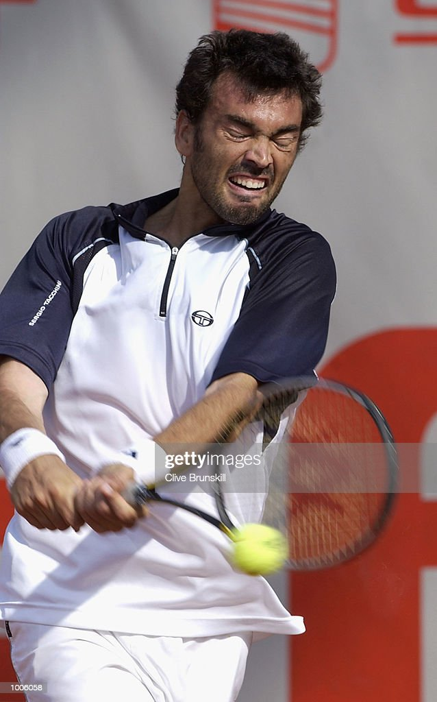 Sergi Bruguera of Spain plays a backhand during his second round match against Guillermo Canas of Argentina during the Open Seat Godo 2002 held in Barcelona, Spain. DIGITAL IMAGE Mandatory Credit: Clive Brunskill/Getty Images