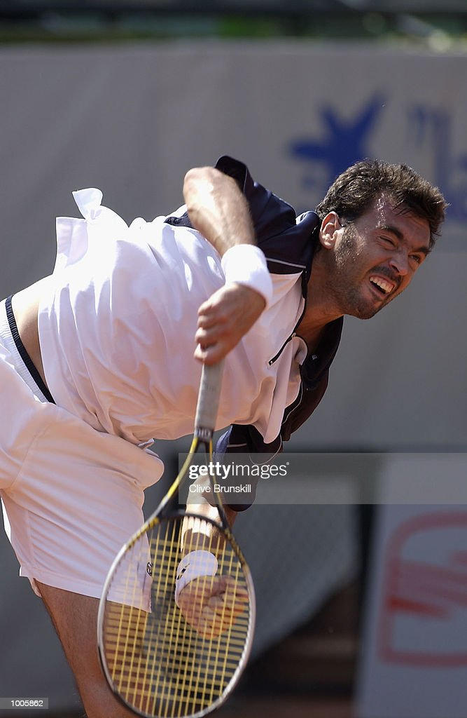 Sergi Bruguera of Spain serves during his first round match against Carlos Cuadrado of Spain during the Open Seat Godo 2002 held in Barcelona, Spain. DIGITAL IMAGE Mandatory Credit: Clive Brunskill/Getty Images