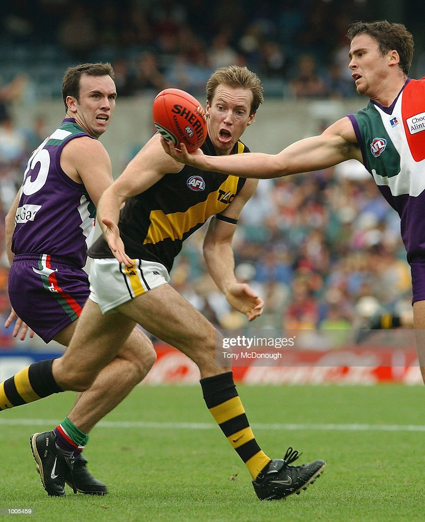 Shane Parker #25 for the Dockers and Paul Hasleby #4 for the Dockers take the ball from Adam Houlihan #23 for richmond during the AFL match between the Fremantle Dockers 138 points and the Richmond Tigers 72 points, played at the SubiacoOval, Western Australia. DIGITAL IMAGE Mandatory Credit: Tony McDonough/Getty Images