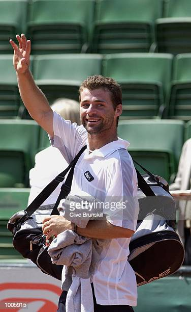 Stefano Galvani of Italy waves to the crowd after defeating Yevgeny Kafelnikov of Russia during the Open Seat Godo 2002 held in Barcelona Spain...