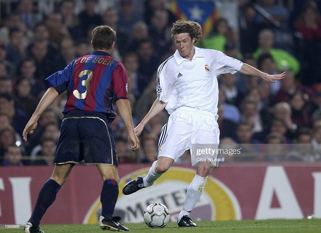 Steve McManaman of Real Madrid attempts to move past Frank De Boer of Barcelona during the UEFA Champions League Semi Final First Leg match between Barcelona and Real Madrid at the Nou Camp, Barcelona, Spain. DIGITAL IMAGE Mandatory Credit:Clive Brunskill/Getty Images