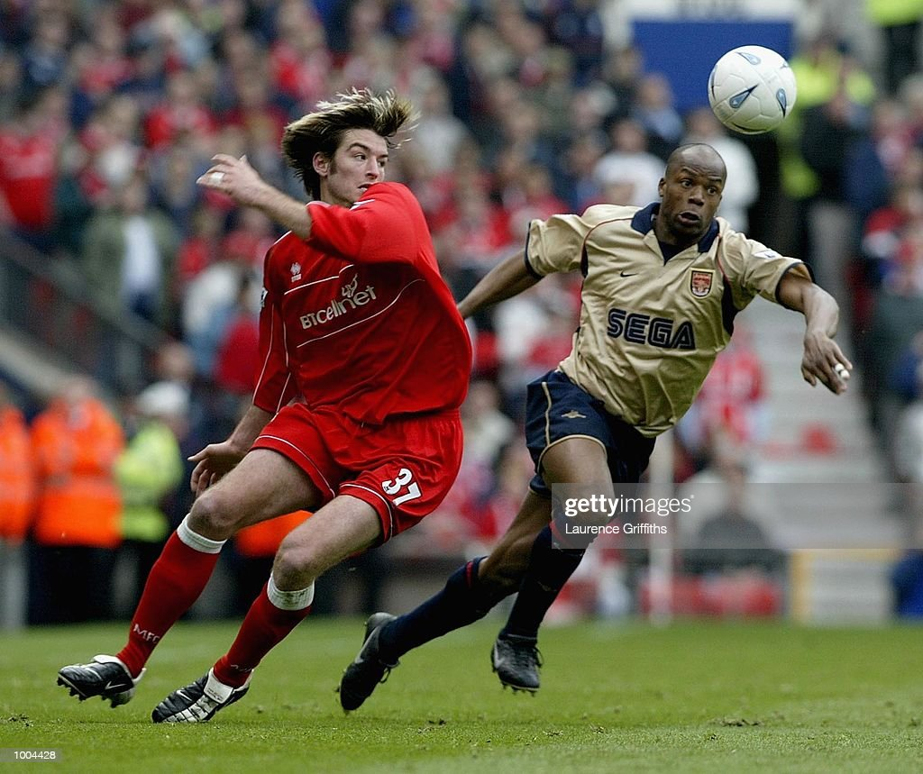 Sylain Wiltord of Arsenal goes past Franck Queudrue of Boro during the AXA sponsored FA Cup semi final tie between Middlesbrough v Arsenal at Old Trafford Stadium, Manchester. DIGITAL IMAGE. Mandatory Credit: Laurence Griffiths/Getty Images