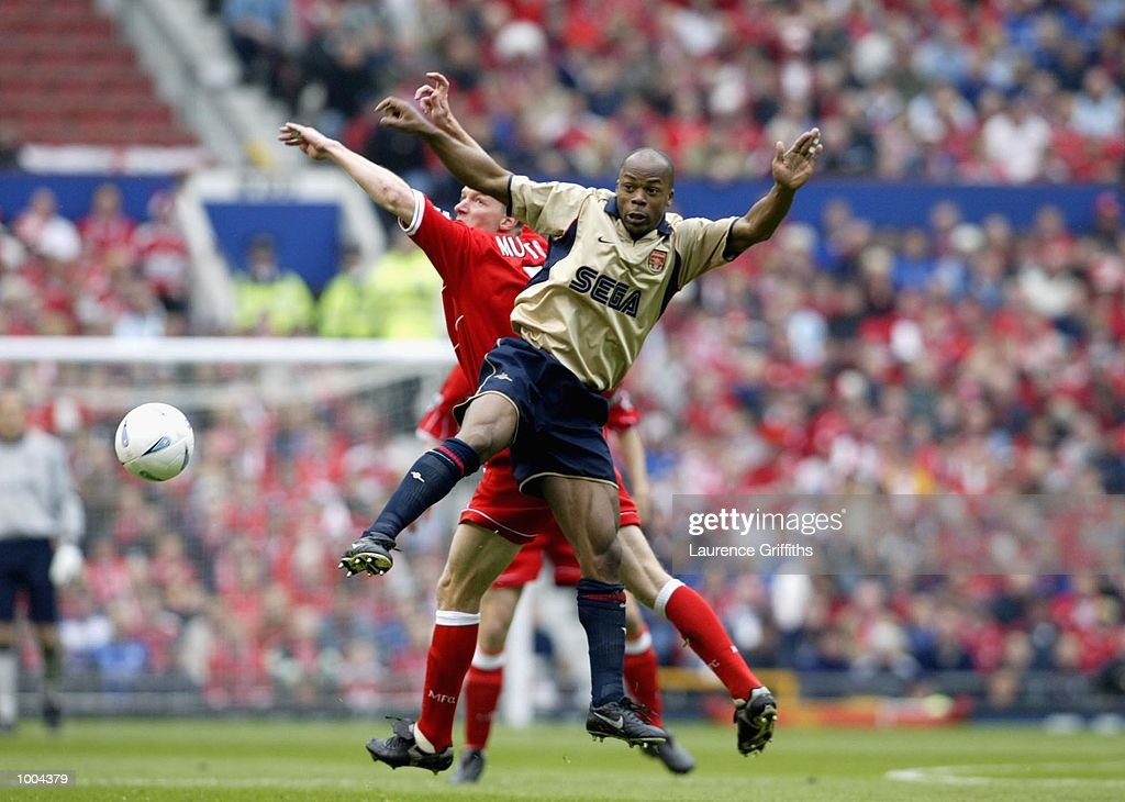 Sylvain Wiltord of Arsenal and Robbie Mustoe of Boro go up for the ball during the AXA sponsored FA Cup semi final tie between Middlesbrough v Arsenal at Old Trafford Stadium, Manchester. DIGITAL IMAGE. Mandatory Credit: Laurence Griffiths/Getty Images