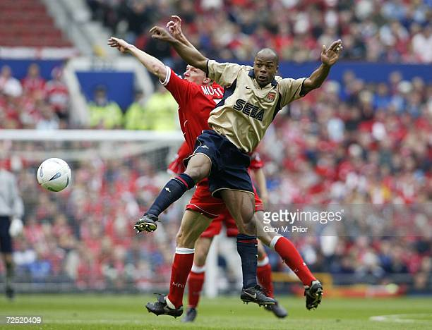 Sylvain Wiltord of Arsenal is challenged by Robbie Mustoe of Middlesbrough during the AXA sponsored FA Cup Semifinal match between Middlesbrough and...