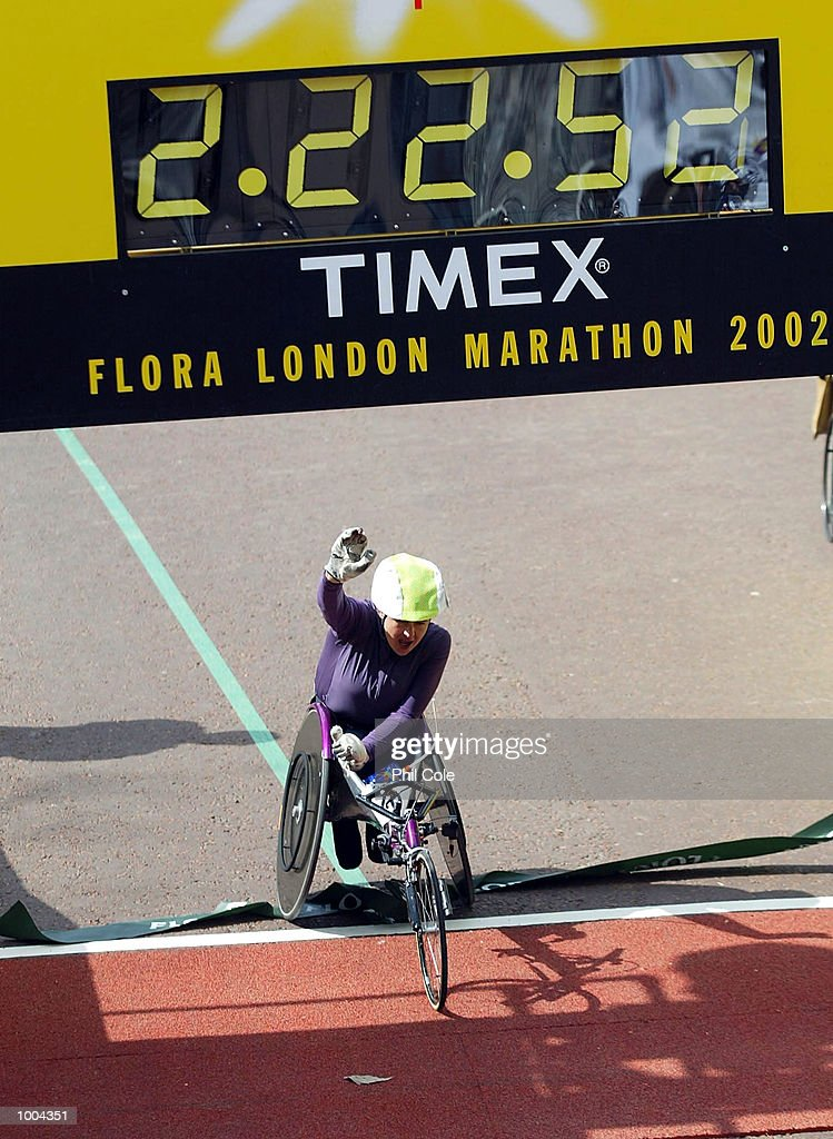 Tanni Grey-Thompson celebrates after winning the Flora London Marathon Womens Wheelchair race London. DIGITAL IMAGE Mandatory Credit: Phil Cole/Getty Images