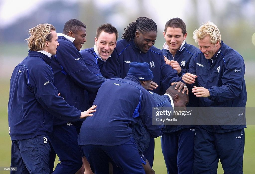 The Chelsea players have a laugh with new player Carlton Cole during a training session at Chelsea's training ground near Heathrow in London, as the team prepare for Sunday's FA Cup semi-final match against Fulham at Villa Park. DIGITAL IMAGE Mandatory Credit: Craig Prentis/Getty Images