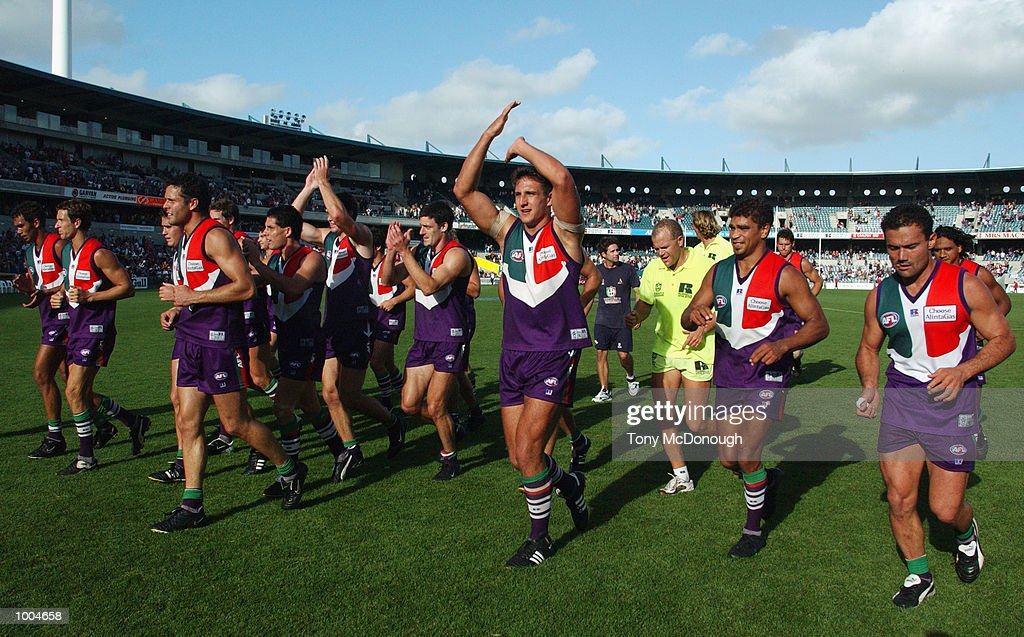 07 Apr 2002:  The Fremantle Dockers team leave the field after winning the round two AFL match betwe