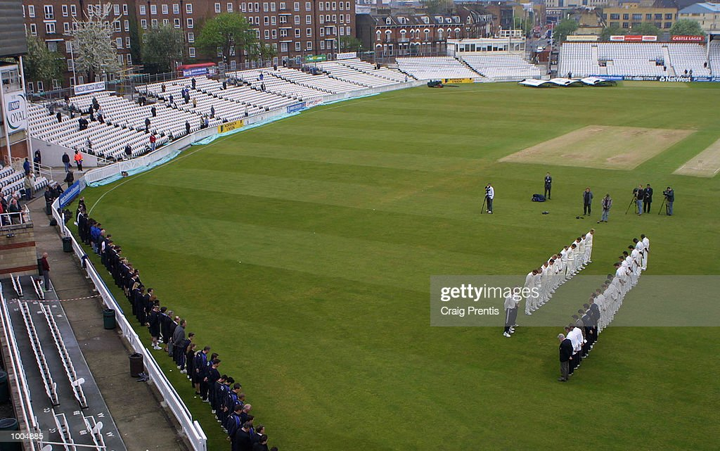 19 Apr 2002. The players of Surrey CCC and Sussex CCC observe a two minutes silence in memory of Ben Hollioake of Surrey and Umer Rashid of Sussex who both died in the closed season during the Frizzell County Championship match at the Oval, London. DIGITAL IMAGE. Picture: CRAIG PRENTIS Mandatory Credit: Craig Prentis/Getty Images
