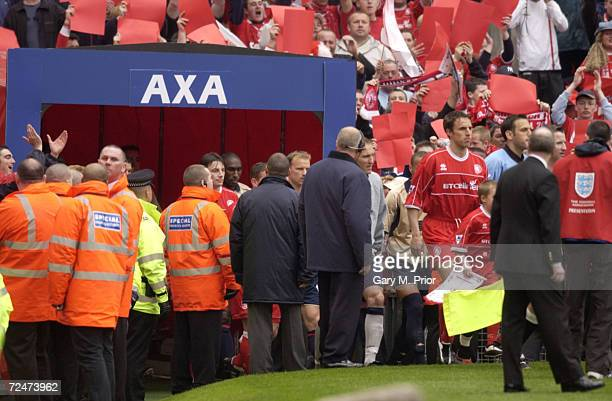 The two teams emerge from the players tunnel for the AXA sponsored FA Cup Semifinal match between Middlesbrough and Arsenal at Old Trafford in...