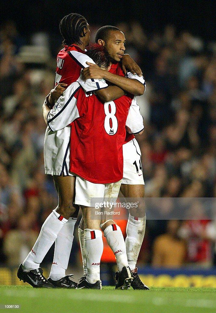Thierry Henry and Fredrik Ljungberg of Arsenal celebrates Kanu goal during the FA Barclaycard Premiership match between Arsenal and West Ham United at Highbury, London. DIGITAL IMAGE Mandatory Credit: Ben Radford/Getty Images