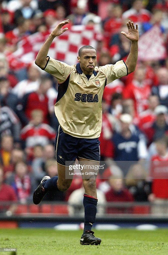 Thierry Henry of Arsenal celebrates after Gianluca Festa of Boro scores an own goal for Arsenal during the AXA sponsored FA Cup semi final tie between Middlesbrough v Arsenal at Old Trafford Stadium, Manchester. DIGITAL IMAGE. Mandatory Credit: Laurence Griffiths/Getty Images