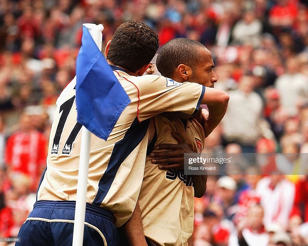 Thierry Henry of Arsenal celebrates Gianluca Festa of Middlesbrough's own goal during the AXA FA Cup Semi Final between Arsenal and Middlesbrough at Old Trafford, Manchester. DIGITAL IMAGE. Mandatory Credit: Ross Kinnaird/Getty Images