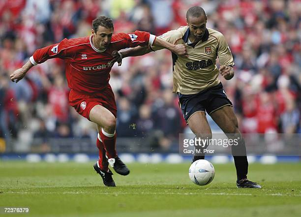 Thierry Henry of Arsenal takes on Gianluca Festa of Middlesbrough during the AXA sponsored FA Cup Semifinal match between Middlesbrough and Arsenal...
