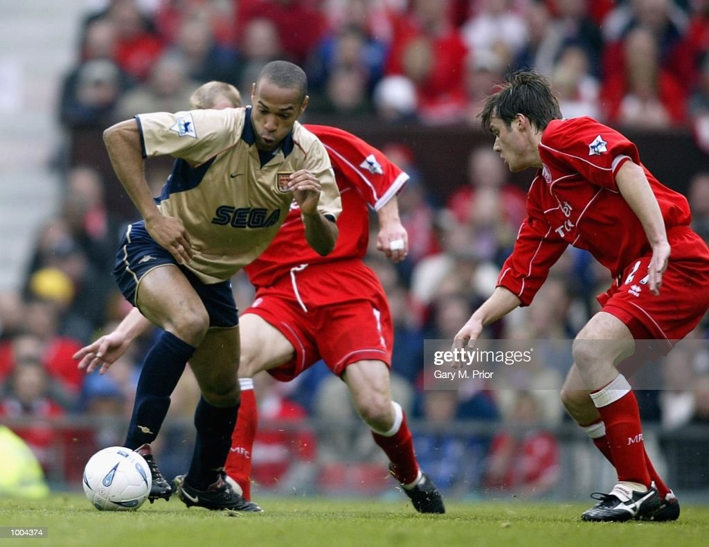Thierry Henry of Arsenal takes on the Boro defence during the AXA sponsored FA Cup semi final tie between Middlesbrough v Arsenal at Old Trafford Stadium, Manchester. DIGITAL IMAGE. Mandatory Credit: Gary M. Prior/Getty Images