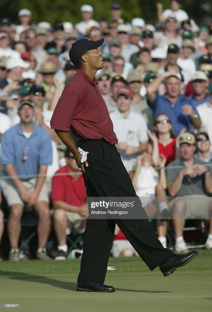 Tiger Woods of the USA after mising his birdie putt on the 18th green during the final round of the Masters Tournament from the Augusta National Golf Club in Augusta, Georgia. DIGITAL IMAGE. EDITORIAL USE ONLY Mandatory Credit: Andrew Redington/Getty Images