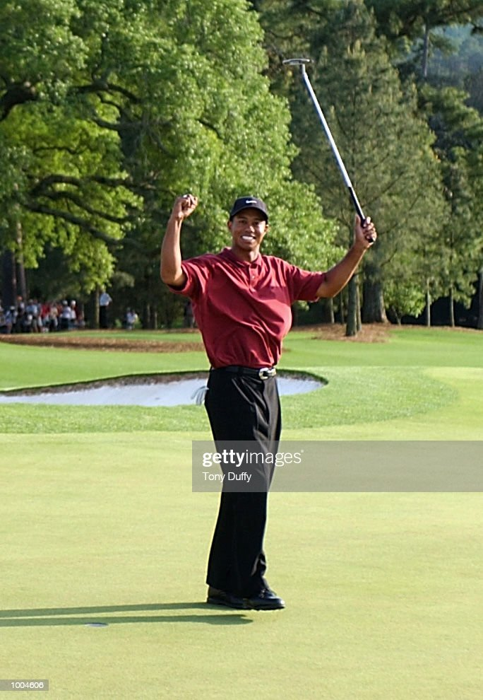 Tiger Woods of the USA celebrates after his victory on the 18th green during the final round of the Masters Tournament from the Augusta National Golf Club in Augusta, Georgia. DIGITAL IMAGE. EDITORIAL USE ONLY Mandatory Credit: Allsport/Getty/Getty Images
