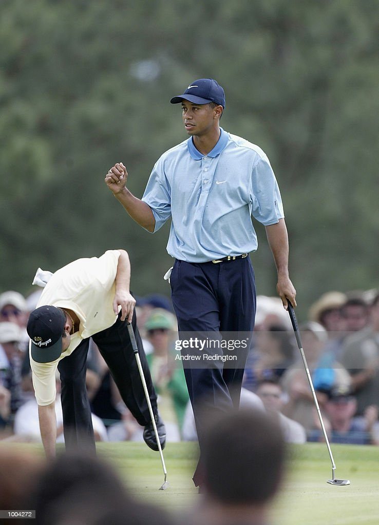 Tiger Woods of the USA celebrates his birdie on the seventh green during the third day of the Masters Tournament from the Augusta National Golf Club in Augusta, Georgia. DIGITAL IMAGE. EDITORIAL USE ONLY Mandatory Credit: Andrew Redington/Getty Images