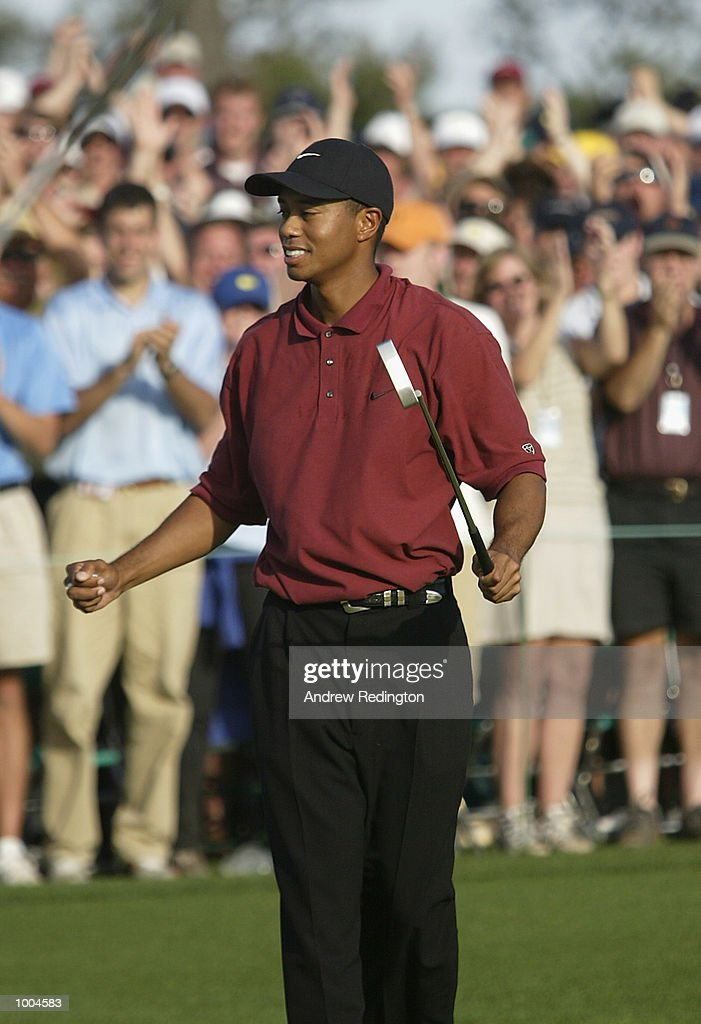 Tiger Woods of the USA celebrates his victory on the 18th green during the final round of the Masters Tournament from the Augusta National Golf Club in Augusta, Georgia. DIGITAL IMAGE. EDITORIAL USE ONLY Mandatory Credit: Andrew Redington/Getty Images