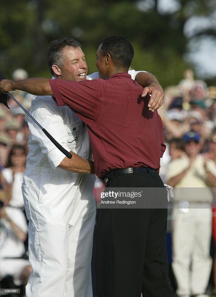 Tiger Woods of the USA celebrates with his caddie Steve Williams after his victory on the 18th green during the final round of the Masters Tournament from the Augusta National Golf Club in Augusta, Georgia. DIGITAL IMAGE. EDITORIAL USE ONLYMandatory Credit: Andrew Redington/Getty Images